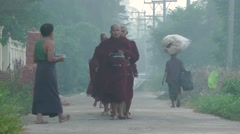 Monks on alms round early morning,Bago,Burma - stock footage