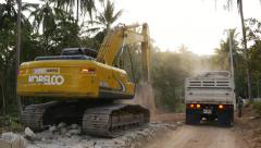 THAILAND, CIRCA 2015: Excavator digging and loading sand into the truck Stock Footage