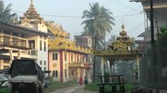 3 ladies walking through Temple Area,Bago,Burma Stock Footage