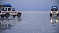 off-road car in Sunset at the Lake Assal, salt lake in the Danakil Depression - stock footage