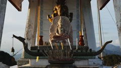 Buddhist Altar with statues of Buddha on top of a mountain. Zoom in footage Stock Footage
