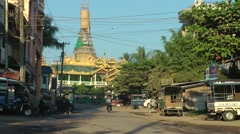 Street with pagoda with motorcycle,Hpa-An,Burma Stock Footage
