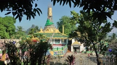Temple near River through trees,Hpa-An,Burma Stock Footage