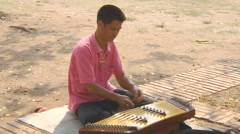 Man playing traditional instrument at the Ayutthaya Park in Thailand Stock Footage
