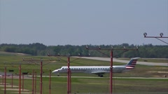 Airplane-13 jet, commercial, American Eagle Canadair CRJ-700 takeoff Stock Footage