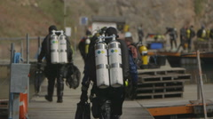 Slow Motion - technical Scuba Diver walks along jetty Stock Footage