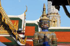 Guardian statue at Royal temple of the emerald Buddha, Bangkok, Thailand - stock photo