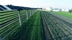 Traditional hayrack next to farmland Stock Footage