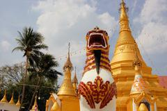 Burmese temple with lion in Sangkhlaburi, Thailand - stock photo