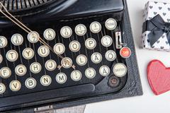 old typewriter with a jewel for valentine day - stock photo