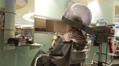 Asian Beautiful Woman Playing With Smartphone In Hair Salon-Dan Stock Footage