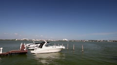 Speedboats moored to a jetty at  lagoon Stock Footage