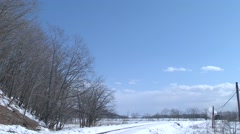 Steam locomotive passing in snowy field, Hokkaido, Japan Stock Footage