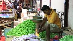 Sellers in street market sell fresh fruits and vegetables. Matara, Sri Lanka Stock Footage