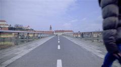 Woman walk on bridge alone towards old city 4K Stock Footage