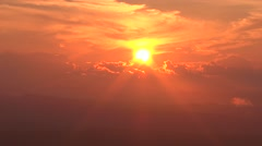 Sun hidden behind the clouds in the red sky Stock Footage