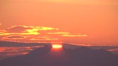 Sun rising behind Mount Shari, Hokkaido, Japan Stock Footage