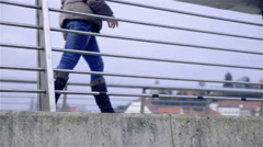 Person stopping at bridge fence resting legs 4K Stock Footage