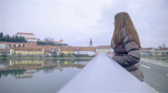 Woman enjoying view of old historic town beside a river 4K Stock Footage
