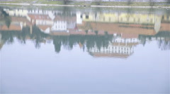 Old city with castle reflection in water 4K Stock Footage