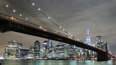 Brooklyn bridge and New York city at night, time lapse - stock footage