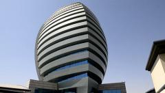 Tilt up to modern building in Khartoum Stock Footage