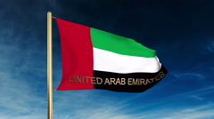 United Arab Emirates flag slider style with title. Waving in the wind with cloud Stock Footage