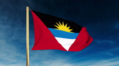 Antigua And Barbuda flag slider style. Waving in the win with cloud background Stock Footage