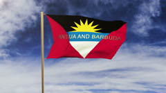 Antigua And Barbuda flag with title waving in the wind. Looping sun rises style Stock Footage