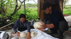 Group of people make round rice cake Stock Footage