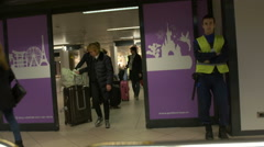 Persons getting passing arrival gates in Henri Coanda Airport in Otopeni. Stock Footage