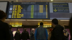 Persons looking at arrival gates in Henri Coanda Airport in Otopeni - stock footage