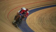 Cyclists to ride fast in a curve close-up Stock Footage