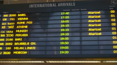 Flight information at a timetable at Henri Coanda Airport in Otopeni Stock Footage