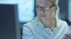 Woman Scientist using Microscope in Laboratory - stock footage