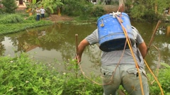 Asian man fishing with electrical equipment Stock Footage