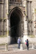 Tourist takes picture of dom tower in utrecht Stock Photos
