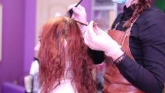 The Process Of Staining Red Hair In Beauty Salon Stock Footage