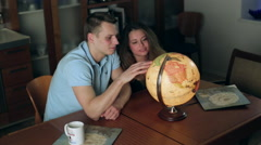 young man and girl are considering Globe romantic - stock footage