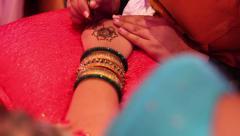 Henna Tattoos in Progress Stock Footage