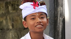 Young boy during the celebration Balinese New Year, Ubud, Bali, Indonesia - stock footage