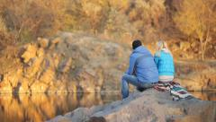 Young man and woman fishing on the lake Stock Footage