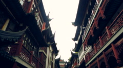 Chinese Pagoda and people on the streets Stock Footage