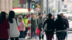 Asian crowd of people on the streets of Shanghai Stock Footage