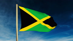 Jamaica flag slider style. Waving in the win with cloud background animation - stock footage