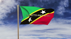 Saint Kitts And Nevis flag with title waving in the wind. Looping sun rises Stock Footage