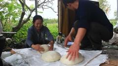 Group of people make round rice cake Stock Footage