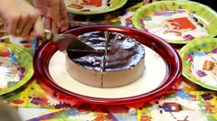 Birthday party in McDonald`s restaurants. Waiter is cutting chocolate cake Stock Footage