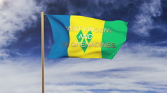 Saint Vincent and the Grenadines flag with title waving in the wind. Looping sun Stock Footage