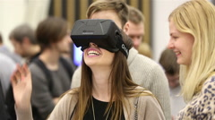 Virtual reality game. Girl uses head mounted display Oculus Rift. - stock footage